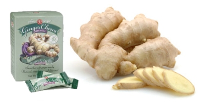 Whole and sliced ginger root in isolated white background